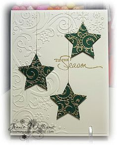 """By Jennie Williams. Punch or die-cut stars. Stamp stars with a background stamp & heat emboss in gold. Dry emboss cardstock panel. Add sentiment (also heat embossed). """"Hang"""" stars with gold cord. Pop up panel on card front."""