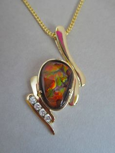 Glenn Dizon Designs.  One of a kind fire agate and diamond pendant no available.  Complete description on Fb page.