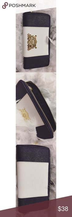 Juicy Couture Wallet Beautiful Juicy couture Wallet , blue navy (dark blue) color and White with some details in color Gold , never use , new , have the Crown 👑 in the front symbol of Juicy Juicy Couture Bags Wallets