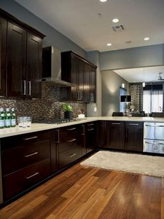 We went for dark wood kitchen designs, and the offer is diversified, so you can pick some of these according to what you wish for for your new kitchen, either built from scratch or that overdue kitchen remodel you have been saving for. Go modern, rustic or minimalist and contemporary, and your kitchen will look great according to our books but remember you have the last saying. The most important part is that among these dark wood kitchen designs you find the kitchen you have been looking… Kitchen Cabinet Color Schemes, Kitchen Paint Colors, Paint Colours, Cabinet Colors, Stain Colors, Floor Colors, Wall Colours, Dark Colors, Color Blue