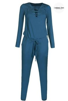 Street Style // Perfect that street style off-duty look with this blue gommet lace-up long sleeves jumpsuit.