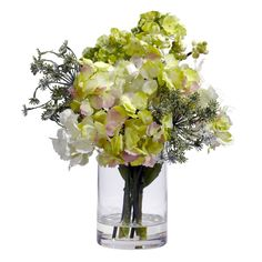 Hydrangea Silk Flower Arrangement - Poofy, Pretty, and Perfect, this Hydrangea silk flower arrangement will please flower lovers everywhere. Several intriguing Hydrangea blooms spout forth from a simple clear vase (complete with liquid illusion faux water) , creating a look that will brighten up any area it adorns. And best of all? The sunny look will brighten your home or office for a lifetime! Number of Trunks: NA Number of Flowers: NA Number of Leaves: NA Pot Size: W: 4 in, H: 6 in Color…