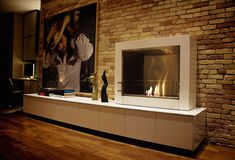 Modern Fireplace Design for Modern Living Room - Do you have problem with a fireplace design which is no more suitable for your modern house? It may because the fireplace needs a chimney shaft or a funnel which isn? Indoor Stone Wall, Modern Outdoor Fireplace, Indoor Fireplaces, Modern Fireplaces, Bio Ethanol, Contemporary Fireplace Designs, Portable Fireplace, Home Fireplace, Fireplace Ideas