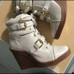 NIB Michael Kors Skid wedge sz 5 Brand new in box Michael Kors Skid Wedge fashion sneaker in Vanilla. Sold out size 5.  Leather, suede, patent leather. Hard to find. Michael Kors Shoes Wedges