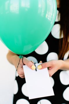 Pictures hanging from balloons - so easy! All you have to do is attach string to the back.