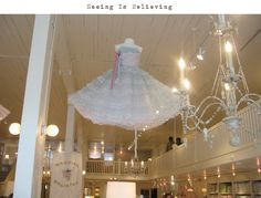 Vintage gowns hanging from the ceiling = perfection