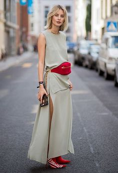 adffe31eee40 Blogger And Street Style Star Lisa Hahnbueck Wearing Red Bumbag And Louis  Vuitton X Supreme Boots With Dress