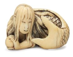 An ivory netsuke of a mermaid By Shuryo, early 19th century