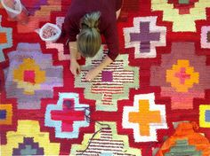 Re Rag Rug: 9.RE ORIENT -My absolute fave!  A crochet rug because the technique is too genius to be left out even if crochet is not new in rug making.  We had many T-shirts in strong red-orange tones donated and the colours led us into the oriental style. The idea of exclusivity meets the idea of popularity.  Size: 210 x 300 cm, Material: T-shirts, Technique: crochet