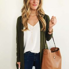 Dark green cardigan, white v neck, hobo bag.