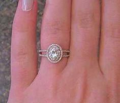 oval engagement ring.halo with tiny champagne diamonds. Heaven I love it I love I love it