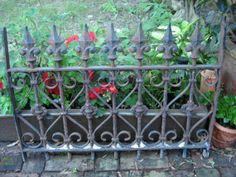 architectural salvaged iron antique 18OOs iron gate ornate heavy cast iron garden fence iron window guard