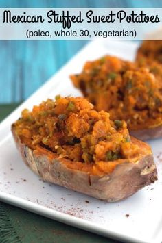 Paleo Mexican Stuffed Sweet Potatoes are stuffed with bell pepper, onion, jalapeno and Mexican spices for the perfect vegetarian side paired with taco salad or fajitas!