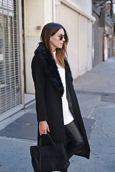 A black faux fur collar such as this one is the perfect way to add some edge to your standard overcoat. Brittany Xavier wears the look with leather trouers and a gorgeous studded Kwani bag. Coat: Missguided, Top: ASOS, Trousers: H&M, Sneakers: Senso, Bag: Kwani Sunglasses: Urban Outfitters.