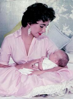 Beautiful photo of Elizabeth Taylor cradles her youngest son Christopher Wilding
