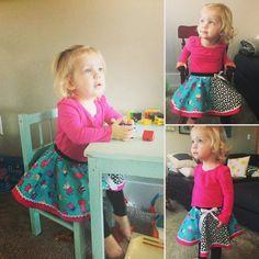 Twin granddaughters wearing their Peppa Pig circle skirts!