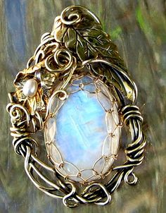Moonstone and pearls by tangocatgems1, via Flickr