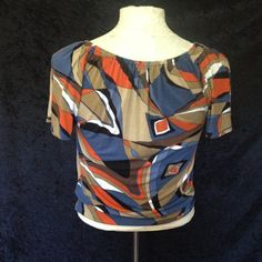 Multi colored Michael Kors top. This top had elastic gathering around the neck area and around both arms for a comfortable fit. Orange brown and blue are your color screen. Michael Kors Tops