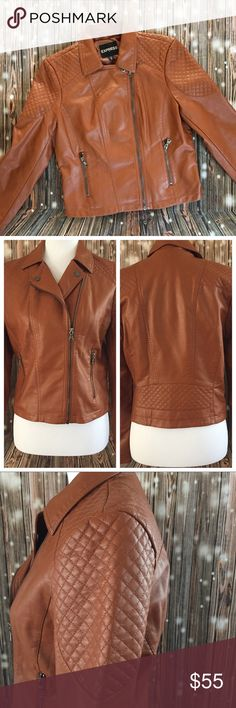 "Express Minus The Leather Quilted Moto Jacket Gorgeous Cognac color for fall. All hardware in pewter. Quilted on shoulder, halfway down arm, and along back. Can be fully zipped or left halfway for a moto jacket look. Two front full zip pockets. Approx 18"" pit to pit, 21"" length, 23"" sleeves. Fully lined. Outside is viscose. Lining is Polyester Express Jackets & Coats"