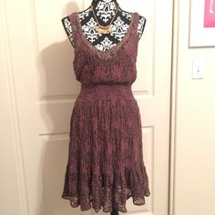 Free People Gorgeous Free People brown and purple lace dress featuring a beaded neckline and elastic waistband. Size large but the lace is stretchy so it can fit any figure. Used but no rips or stains to my knowledge. Please let me know if you have any questions. Free People Dresses