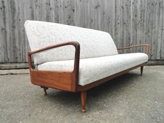 The sofa bed operates as a day sofa and can be turned into a bed by pushing down on a foot lever to the rear of the sofa so that both parts lay flat.