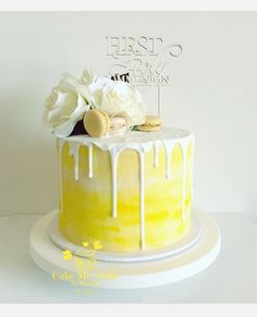 First Holy Communion yellow watercolour drip cake by Cake Me Smile By Natalie https://m.facebook.com/cakemesmilebynatalie/