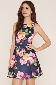 A sleeveless woven dress featuring an allover floral rose print on a fit and flare silhouette with an invisible back zipper.  #blueroofind