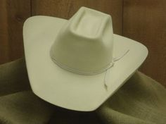 http://catalenahats.com/ Catalena Hatters offers many custom felt hat styles to suit any cowboy needs. Browse our custom felt hat products to build your perfect felt cowboy hat.