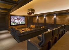 Kick back and watch your favorite sporting event or movie in this casual home theater! | www. hitechhome.net - Your Home Theater Experts