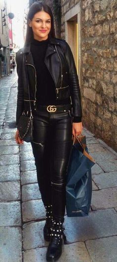 Black leather pants and jacket outfit with ankle boots