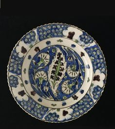 Dish   Made in Damascus, Syria, ca. 1600   Materials: fritware, polychrome underglaze painted, glazed   Syrian potters working in Damascus produced the best provincial versions of Iznik pottery. Typically the palette of the colours and designs imitate Iznik wares made around 1550 (almost fifty earys earlier)   VA Museum, London