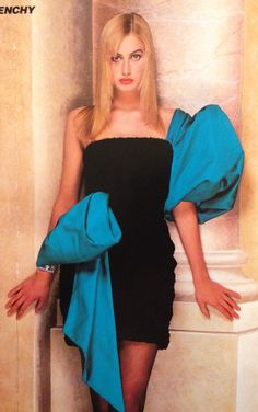 Givenchy Haute Couture- A/W 1987-88 Black velvet strapless mini dress with a silk satin teal single sleeve and waist sash. L'Officiel No. 734- September 1987