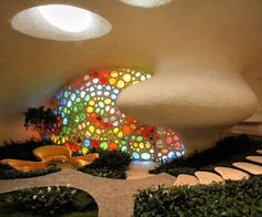 the nautilus. unbelievable! there is only one of these, so i can't have it. i've seen cob and straw bale homes utilizing glass bottles to make colorful windows like this.