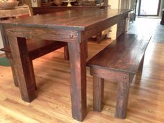 Distressed dining table with benches. love the stain shade, hardware accents and rustic nature