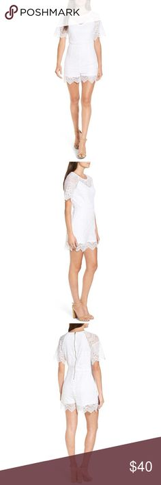 """White lace romper Romantic floral lace veils a sumptuous romper enhanced by its alluring illusion neck and flirtatious eyelash trim. 30"""" length. Back zip closure. Jewel neck. Short sleeves. Lined. 70% cotton, 30% nylon. Machine wash cold, line dry. By Love, Fire; imported. Sold out in stores. New Love, Fire Shorts"""