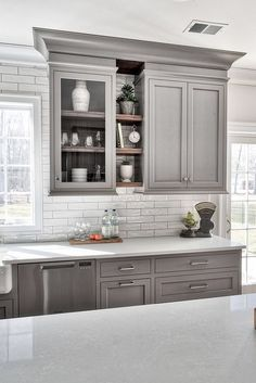 Home Decor Classy Grey kitchens will never go out of style. These photos of kitchens with gray cabinets will inspire you to embrace this trendy neutral. We're going over painted gray cabinets, farmhouse grey kitchens, dark gray kitchens, modern kitchen Kitchen Cabinet Design, Interior Design Kitchen, Home Design, Kitchen Shelves, Kitchen Layout, Kitchen Colors, Open Cabinet Kitchen, White Kitchen Interior, Grey Interior Design