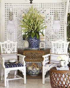 Cane, blue and white ginger jars, pineapples and greenery