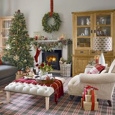 Red and white Christmas living room with tartan carpet
