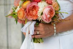 Lush Coral Bouquet of Garden Roses, Ranunculus and Anemone  | Floral Design by Amber Reverie | See More: http://blog.amberreverie.com/2014/09/heather-and-alex-formals.html