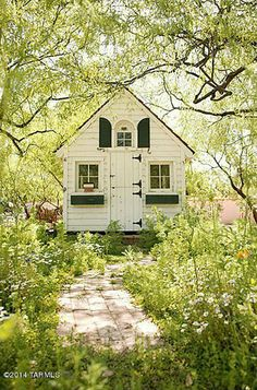 This adorable white playhouse with the green shutters and window boxes belonged to singer Linda Ronstadt's daughter.