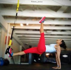 TRX Single-leg Suspended Bridge-facing anchor, one foot in foot cradle, on forearms/wrists. Lift hips to find balance. Free leg comes to side first, more advanced-lift free leg towards ceiling. Advanced-small circles