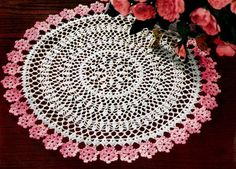 Flowers doily crochet pattern from Doilies, originally published by American Thread Co, Star Book No. 124, in 1955.