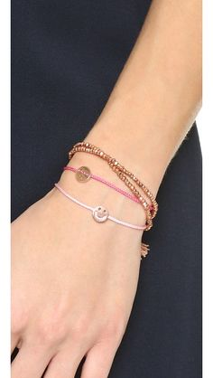 A winking smiley face charm slides along the woven cord of this Ruifier bracelet. Petite aglets tip the cord. Adjustable length.
