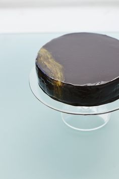 Chocolate Lustre Cake: with dark and milk chocolates, ganache crumb coat, choc mirror glaze, and a touch of edible gold dust.