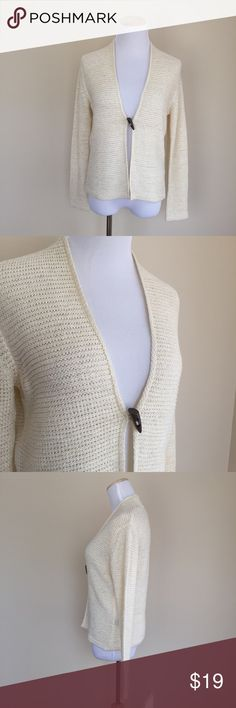 """August Silk wood toggle cardigan sz S August Silk cream cardigan with wooden toggle, size S.  Openwork ribbed knit, textured material, classic design.  Condition:  excellent pre-loved.  Flaw:  back of interior neckline had a trim piece that has been removed (photo 6).  Material:  65% acrylic/35% nylon.  Measurements (approximate, taken laying flat): length 21.5"""", pit-to-pit 19"""". Flat waist 16"""", flat hem 17.75"""", sleeve 23"""". august silk Sweaters Cardigans"""