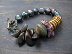 Rings of Jupiter - OOAK artisan lampwork, wood, rustic pearl, sari silk and copper bracelet. by PreciousViolet on Etsy