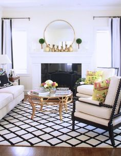 These look just like our Maarten chairs from Lexington. Mirror over mantel, draperies flanking, black and white...love!