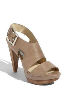 Free shipping and returns on MICHAEL Michael Kors 'Carla' Sandal at Nordstrom.com. Geometric cutouts add a touch of modernism to an urbane sandal styled with a wide metal buckle and conical stacked heel.