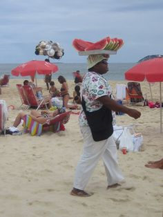 Men selling watermelon and hats at Ipanema beach, Rio de Janeiro, Brazil. (Photo: Thamya)