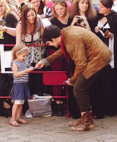 Colin and his tiny fans ♥HER FACE!!! She is so happy oh my gosh. I love him so much.